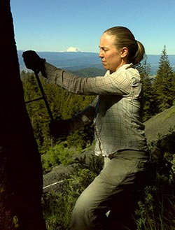 Erika Wise taking a sample of a tree ring