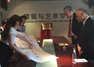 Bill Rohe (second from right) and Roberto Quercia (right) are presented with calligraphy to honor the emerging collaboration between UNC-CH and BJTU.