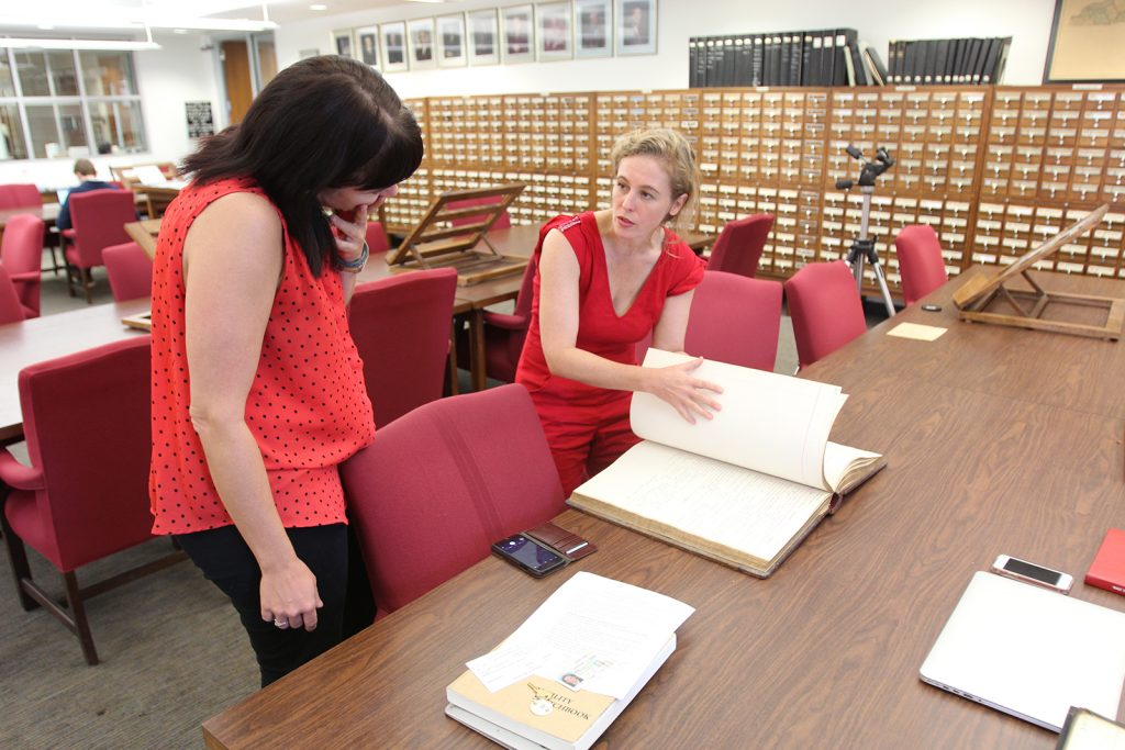 Sarah Almond, Dix Park project coordinator for CHW, and Tift Merritt working in the State Archive Reading Room. Photo: Will Bosley