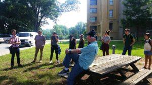 Bobby Allen, Tift Merritt and the Community Histories Workshop team touring Dix Park with artist Annie Temmink and designer Micah Kessel.