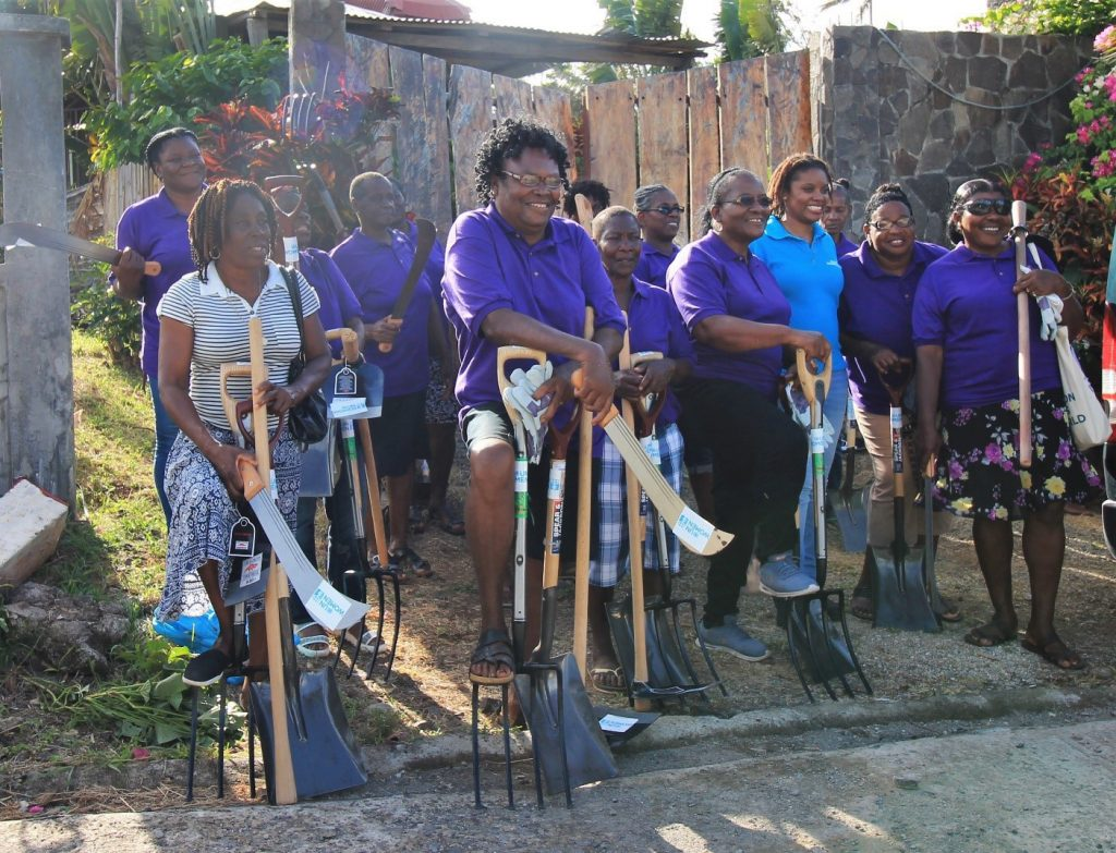 Members of the Northeast Women in Agriculture Movement show off new agricultural tools and supplies donated by UN Women. 2018. Photo: Samantha King.