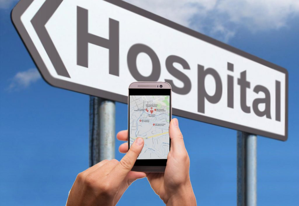 mobile phone and hospital sign
