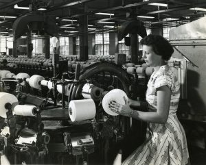 Ruth Williams Howell operating an automatic winder at Rocky Mount Mills. Date unknown.